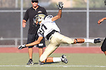 Beverly Hills, CA 09/23/11 - Jaquan Young (Peninsula #10) in action during the Peninsula-Beverly Hills frosh football game at Beverly Hills High School.