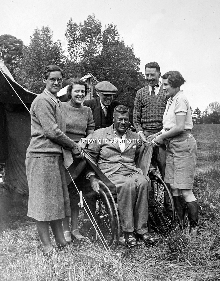 BNPS.co.uk (01202 558833)<br /> Pic: Bonhams/BNPS<br /> <br /> Capt Dunn in his wheelchair on a famiy outing with the motorhome.<br /> <br /> The interior was designed around Capt Dunn's wheelchair after he contracted polio on his honeymoon.<br /> <br /> Britain's first motorhome revealed - As eccentric British pioneers 80 year old home on wheels trundles up for auction.<br /> <br /> The pre-war creation of Capt Dunn, an aristocrat from Bexhill-on-Sea, is believed to be the earliest motorhome in the UK.<br /> <br /> Enterprising Dunn shipped a Pontiac Six chassis over from America in 1935, engaged local coach builders to craft a bespoke<br /> <br /> home from home on to the back, and then set off into the British countryside in his new creation.<br /> <br /> The unique vehicle has been untouched since Dunn died in the 1940's and auctioneers Bonhams are now selling the time capsule<br /> <br /> camper at the Goodwood Revival on 10th September with a £40,000 estimate.