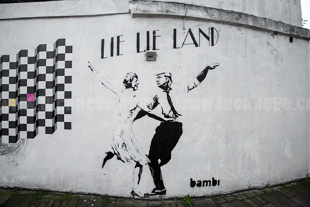 London, 28/02/2017. Artwork from the famous graffiti artist Bambi stencilled on a wall in the London Borough of Islington. The mural features the British Prime Minister Theresa May waltzing with the President of the United States Donald Trump. The stencil is called &quot;Lie Lie Land&quot;, clearly inspired by the Bafta and Oscar award winning film &quot;La La Land&quot;, featuring Emma Stone and Ryan Gosling.<br />