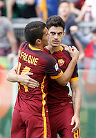 Calcio, Serie A: Lazio vs Roma. Roma, stadio Olimpico, 3 aprile 2016.<br /> Roma's Diego Perotti, right, celebrates with teammate Iago Falque after scoring during the Italian Serie A football match between Lazio and Roma at Rome's Olympic stadium, 3 April 2016.<br /> UPDATE IMAGES PRESS/Isabella Bonotto