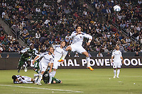 Juan Pablo Angel (9) of the LA Galaxy with a clearing head ball. The LA Galaxy defeated the Portland Timbers 3-0 at Home Depot Center stadium in Carson, California on  April  23, 2011....