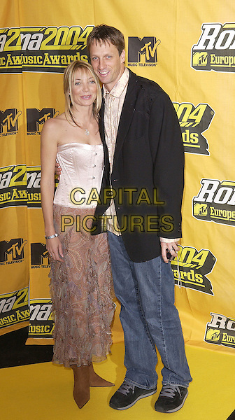 TONY HAWK.MTV Europe Music Awards 2004.November 18th, 2004.full length, jeans, denim, black suit jacket, strapless.www.capitalpictures.com.sales@capitalpictures.com.©Capital Pictures