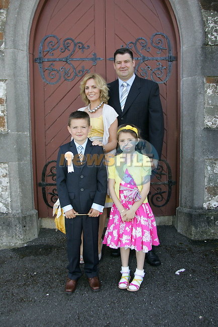 John Prendergast, who made his First Communion on Saturday at Clogherhead church, pictured with sister Ava, mum Lisa and dad John.