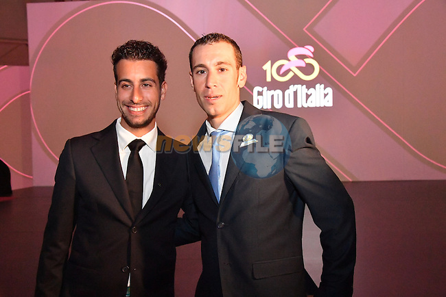 Fabio Aru and defending Champion Vincenzo Nibali at the 100th edition Giro d`Italia 2017 route presentation held at the Ice Palace in Milan, 25th October 2016.<br /> Picture: ANSA/Claudio Peri | Newsfile<br /> <br /> <br /> All photos usage must carry mandatory copyright credit (&copy; Newsfile | ANSA/Claudio Peri)
