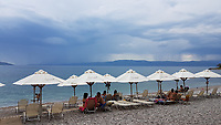 WEATHER PICTURE<br /> Dark clouds and rain are seen over the bay of south Evia minutes before a monsoon type storm hits Nireas beach near Aliveri on the island of Evia, Greece. The country has been experiencing recent heatwaves. Thursday 27 July 2017
