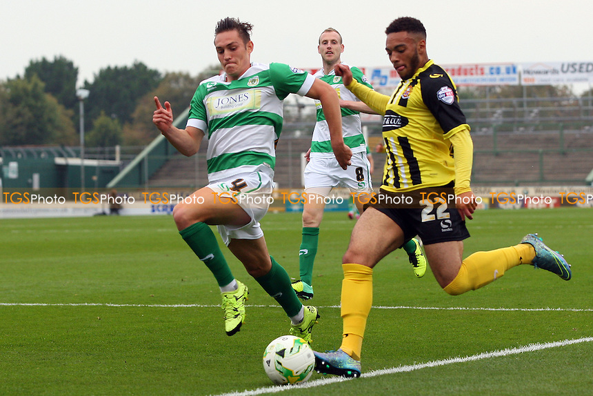 Jake Mulraney of Dagenham and Connor Roberts of Yeovil Town during Yeovil Town vs Dagenham and Redbridge, Sky Bet League 2 Football at Huish Park, Yeovil, England on 10/10/2015