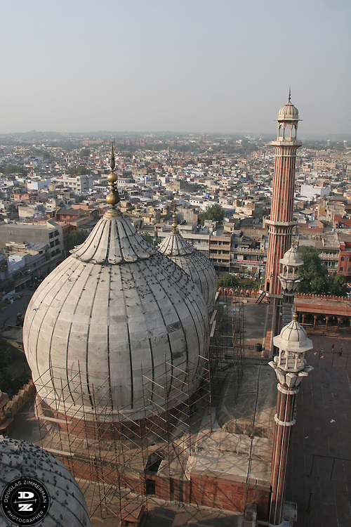 A view from the southern minaret of the Jama Masid mosque with the city of Delhi, India in the background.  The mosque, the largest in India, was completed in 1658.  Photograph by Douglas ZImmerman