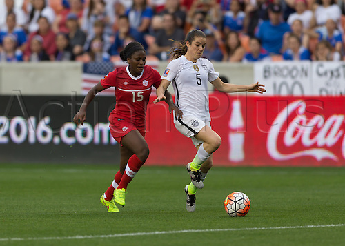 21.02.2016. Houston, TX, USA.  Canada Forward Nichelle Prince (15)  and USA Defender Kelley O'Hara (5) during the Women's Olympic qualifying soccer final match between Canada and USA at BBVA Compass Stadium in Houston, Texas.