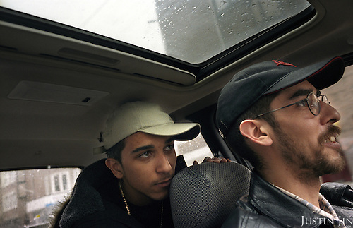 Dutch-Turkish teenager Hakan Dinc sits behind his father in their car in Amsterdam. .Dinc, 16, was born in the Netherlands. His grandparents from his father?s side came from Turkey in 1971, and his mother came in 1987. His father is 31. .Dinc feels more Turkish than Dutch, most of his friends are Turkish and he wants to marry a Turkish girl. During his time off he works in his uncle?s grocery store. Later, he wants to have his own shop. Dinc is following a Commerce course at a vocational school in Amsterdam. .Dinc likes music, pool and chilling out. He has a fourteen-year-old sister and a brother aged ten months. .Picture shot in Amsterdam in 2004 by Justin Jin. .