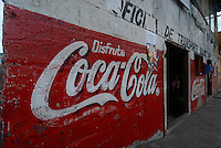 Red Coca Cola sign on front of bus station, Boquete, Panama