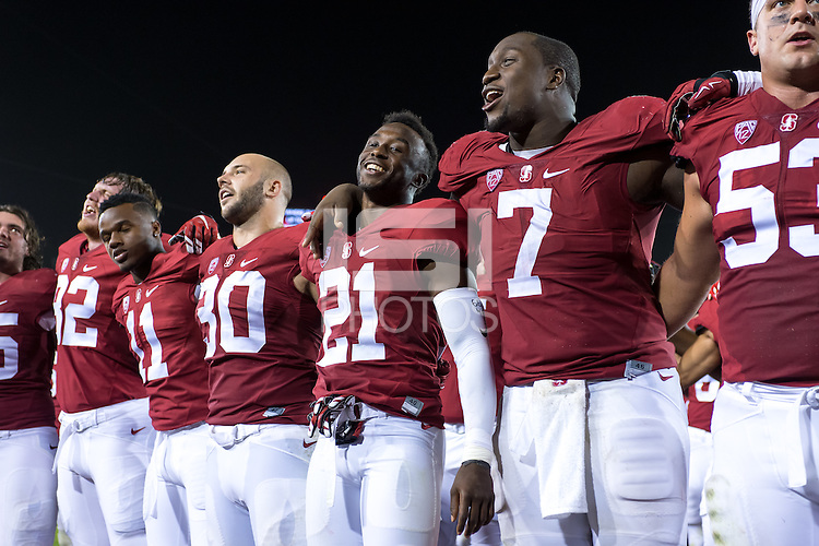 """Stanford, CA - October 15, 2015: Team celebrates during \""""Hail, Stanford, Hail!\"""" after the Stanford vs UCLA football game at Stanford Stadium. The Cardinal defeated the Bruins 56-35."""