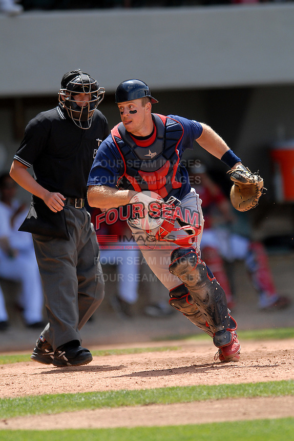 Catcher Eric Kratz #19 of the Lehigh Valley Iron Pigs during a game versus the Pawtucket Red Sox on June 19, 2011 at McCoy Stadium in Pawtucket, Rhode Island. (Ken Babbitt/Four Seam Images)