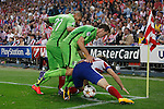 Atletico de Madrid´s Ansaldi (R) and Juventus´s Pereyra and Lichtsteiner during Champions League soccer match between Atletico de Madrid and Juventus at Vicente Calderon stadium in Madrid, Spain. October 01, 2014. (ALTERPHOTOS/Victor Blanco)