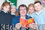 Poetry Party: Enjoying some poetry with Gabriel Fitzmaurice to celebrate World Book Day on Friday were pupils of Killahan National School, Abbeydorney Emily Moriarty, Rachel Conway, Linda Fitzgerald Scanlon and Oisin Maunsell.   Copyright Kerry's Eye 2008