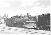 RGS 2-8-0 #41 with pilot wedge plow parked in yard, perhaps Ridgway.  #42 appears to be on the right.<br /> RGS  Ridgway ?, CO