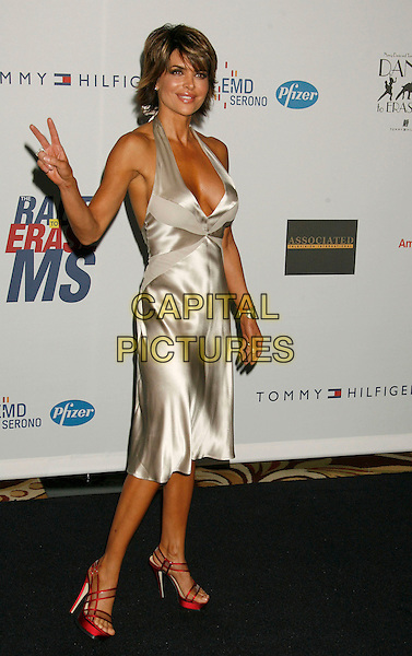 "LISA RINNA.14th Annual Race to Erase MS Themed ""Dance to Erase MS"" held at the Century Plaza Hotel, Century City, California, USA, 13 April 2007..full length silver halterneck dress red shoes peace sign gesture.CAP/ADM/RE.©Russ Elliot/AdMedia/Capital Pictures."