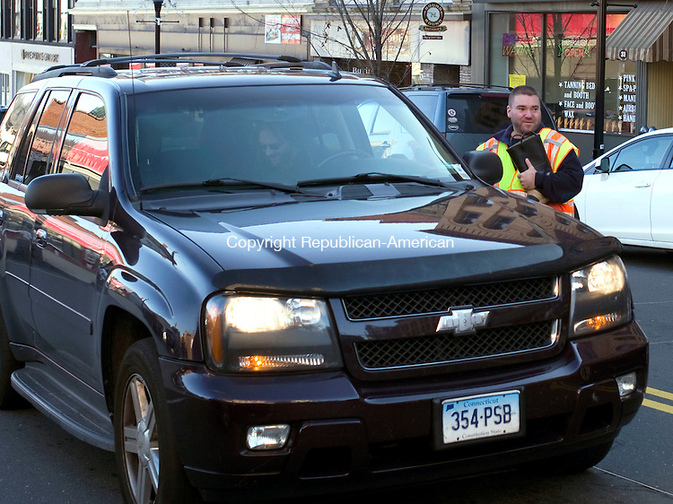 Torrington, CT- 05 December 2015-120515CM04-  Chris Tessman, a firefighter with the Drakeville Volunteer Fire Department takes a donation during a toy and food drive put on by WAPJ, Torrington's community radio station and the Drakeville Volunteer Fire Department in Torrington on Saturday.  Proceeds from the event will go towards the Friendly Hands Food Bank.      Christopher Massa Republican-American