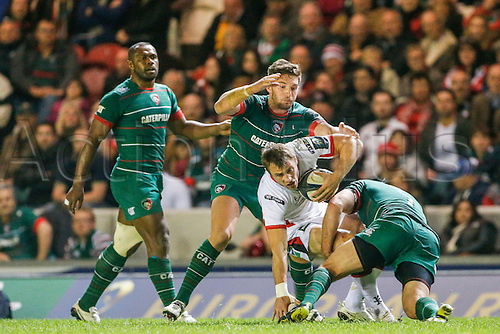 18.10.2014.  Leicester, England.  European Rugby Champions Cup. Leicester Tigers versus Ulster.  Tommy Bowe of Ulster Rugby is tackled by Marcos Ayerza (front) and Owen Williams of Leicester Tigers.   Final score: Leicester Tigers 25-18 Ulster Rugby.