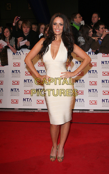 JENNIFER METCALFE .National Television Awards at the O2 Arena, London, England..January 26th 2011.NTA NTAs full length dress hand on hips gold shoes white beige cleavage .CAP/ROS.©Steve Ross/Capital Pictures