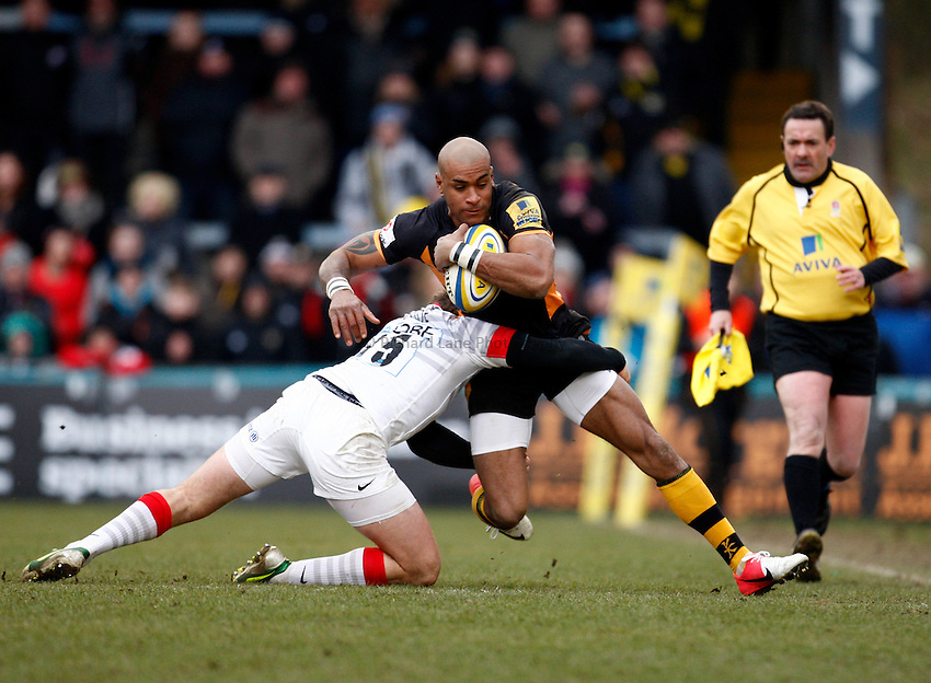 Photo: Richard Lane/Richard Lane Photography. London Wasps v Saracens.  Aviva Premiership. 30/03/2013. Wasps' Tom Varndell is tackled by Saracens' Alex Goode.