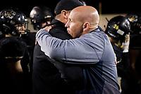 NWA Democrat-Gazette/CHARLIE KAIJO Bentonville West High School head coach Bryan Pratt hugs Bentonville High School head coach Jody Grant after a 31-7 loss, Friday, November 2, 2018 at Bentonville High School in Bentonville.