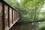 Old railroad bridge along the railroad bed in Fremont, New Hampshire USA which crosses the Exeter River