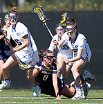 DURHAM, NC - FEBRUARY 26: Notre Dame's Savannah Buchanan (8) tries to keep the ball away from Duke's Anne Slusser (right) and Maura Schwitter (5). The Duke University Blue Devils hosted the University of Notre Dame Fighting Irish on February, 26, 2017, at Koskinen Stadium in Durham, NC in a Division I College Women's Lacrosse match. Notre Dame won the game 12-11.