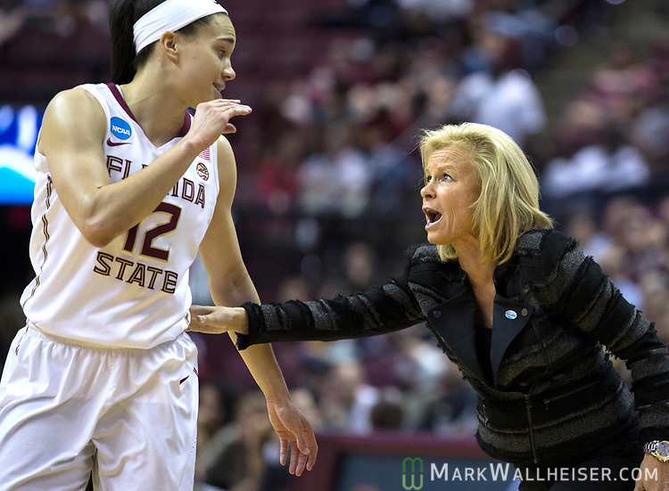 Florida State head coach Sue Semrau talks with Florida State guard Brittany Brown during the second half of a second-round game of the NCAA women's college basketball tournament against Missouri in Tallahassee, Fla., Sunday, March 19, 2017. Florida State defeated Missouri 77-55. (AP Photo/Mark Wallheiser)