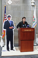 "Kevin Floyd, 30, is awarded a beef tongue for his winning entry to a contest sponsored by Chicago Tribune columnist John Kass to name former Illinois Governor Rod Blagojevich's memoirs outside the Tribune Tower in Chicago, Illinois on March 6, 2009.  The winning entry, Rod and the Giant Impeach, surged ahead in the final minutes the online contest was open, leading Kass to speculate on Chicago-style tactics in his column; the beef tongue was awarded ""in symbolic anticipation"" that the former governor will ""sing to the feds."""
