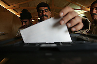 an iraqi soldier from 3d battalion, 1st brigade, 2nd Iraqi Army division  votes in the Iraqi National elections at their base in Camp Ramadi at a poling site under the administration of the Indipendent Electoral Commision of Iraq on Mon Dec 12 2005. At the end of the day about 2000 soldiers will vote at this site according to An Iraqi official.