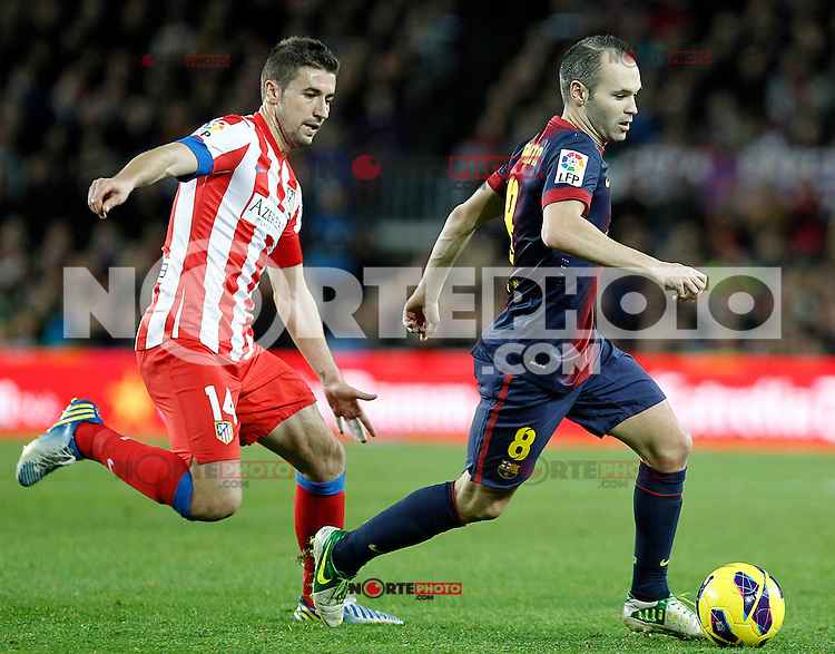FC Barcelona's Andres Iniesta (r) and Atletico de Madrid's Gabi Fernandez during La Liga match.December 16,2012. (ALTERPHOTOS/Acero)