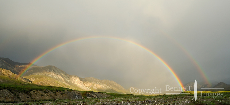 A double rainbow forms near the headwaters of the Hulahula River, which flows north from Alaska's Brooks Range mountains to the Coastal Plain in the Arctic National Wildlife Refuge.