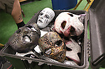 Slipknot masks in a bin.