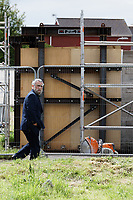 Pictured: Owner John Brandler on site. Tuesday 28 May 2019<br /> Re: Contractors are working to move Banksy's Season Greeting, now owned by John Brandler, which appeared on a garage wall in Port Talbot, to a new location in the same town in south Wales, UK.