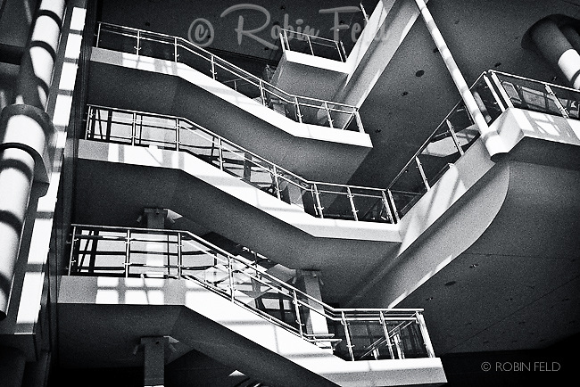 Black and white interior of Schuster Center showing steps and balcony