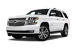 Stock pictures of low aggressive front three quarter view of a 2018 Chevrolet Tahoe Premier 2WD 5 Door SUV