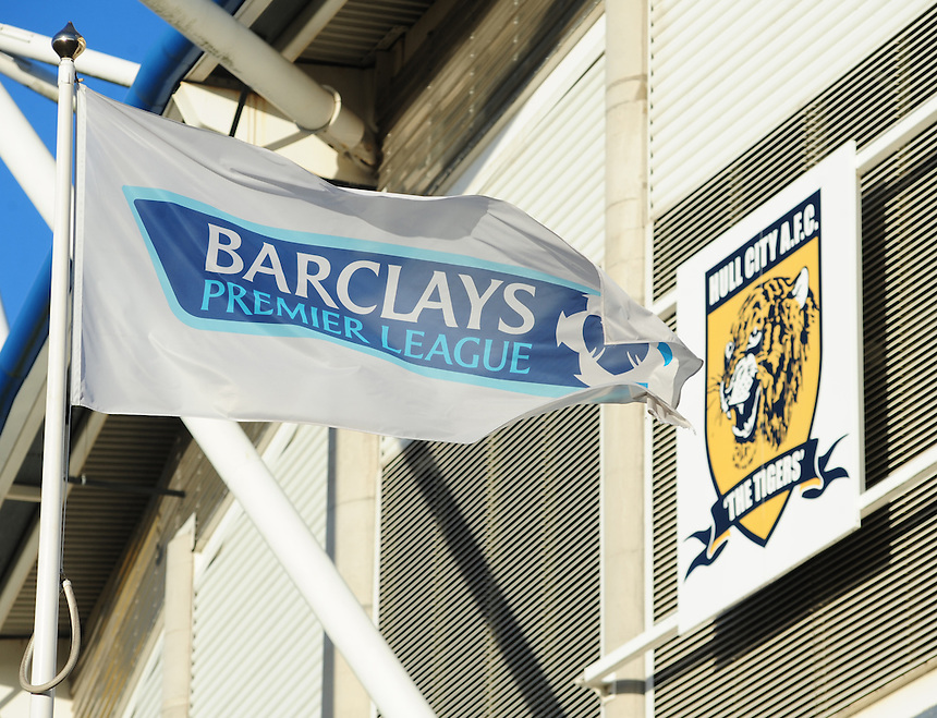 A general view of the Kingston Communications Stadium, home of Hull City as a Barclays Premier League flag flies in front of the club badge on the side of the stadium<br /> <br /> Photo by Chris Vaughan/CameraSport<br /> <br /> Football - Barclays Premiership - Hull City v Fulham - Saturday 28th December 2013 - Kingston Communications Stadium - Hull<br /> <br /> &copy; CameraSport - 43 Linden Ave. Countesthorpe. Leicester. England. LE8 5PG - Tel: +44 (0) 116 277 4147 - admin@camerasport.com - www.camerasport.com