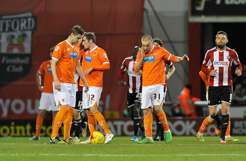 Blackpool players after going behind last night<br /> <br /> Photographer Ashley Western/CameraSport<br /> <br /> Football - The Football League Sky Bet League One - Brentford v Blackpool - Tuesday 24th February 2015 - Griffin Park - London<br /> <br /> &copy; CameraSport - 43 Linden Ave. Countesthorpe. Leicester. England. LE8 5PG - Tel: +44 (0) 116 277 4147 - admin@camerasport.com - www.camerasport.com