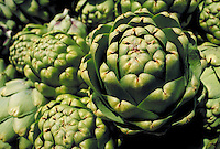 close-up of a cluster of freshly harvested artichoke plants . vegetable, crop, agriculture, harvest, green, food, symmetry. California.