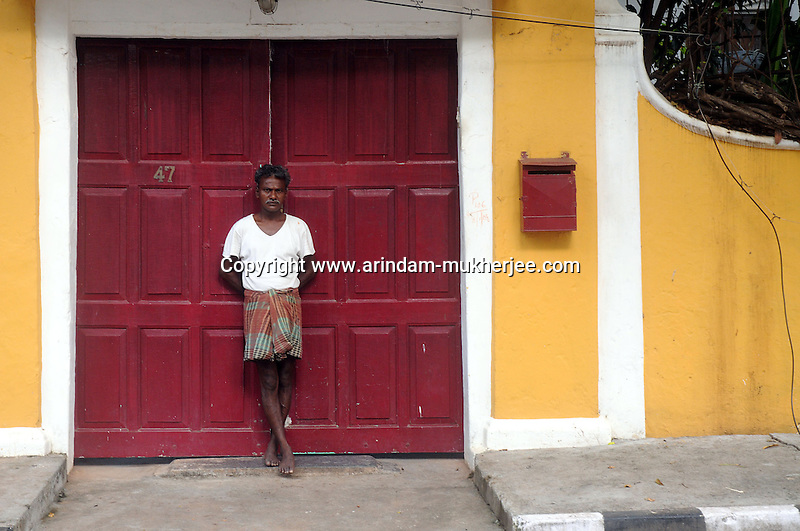 An Indian man standing in front of a building with French touch in the French colony in Pondicherry.Arindam Mukherjee/Sipa