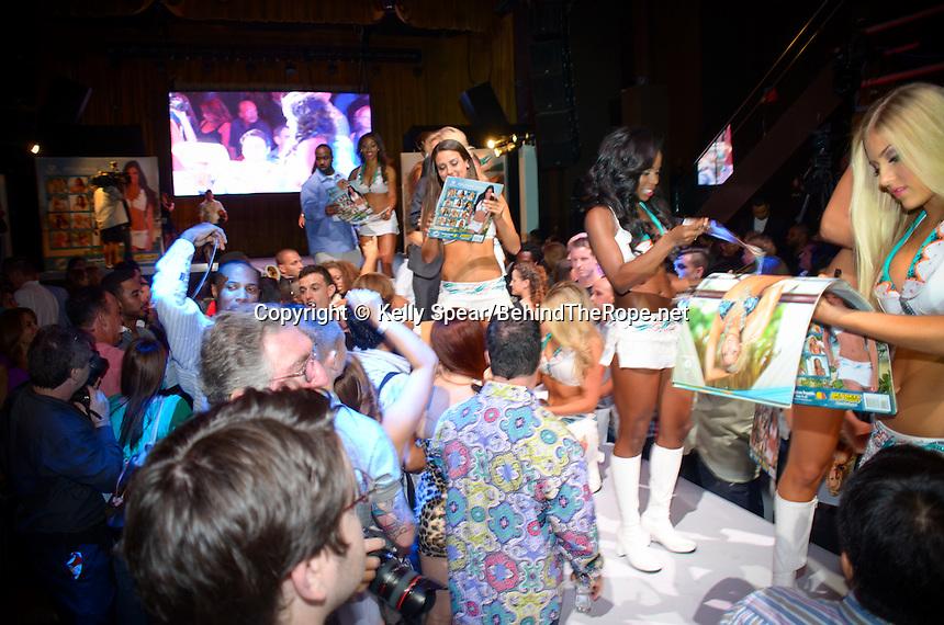 Miami dolphins cheerleader walks runway at miami dolphins for Runway club miami