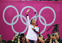 London, England - Thursday, August 2, 2012: USA's Gabrielle Douglas waves to the crowd after winning gold in the women's gymnastics individual all around at the London 2012 Summer, Olympic Games, North Greenwich Arena, London. .