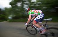 Andr&eacute; Greipel (DEU) racing back into the peloton after a mechanical<br /> <br /> 2013 Ster ZLM Tour <br /> stage 4: Verviers - La Gileppe (186km)