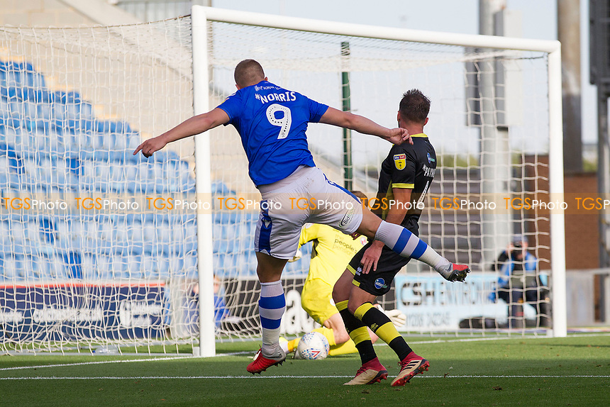 Luke Norris of Colchester United fires an attempt on goal which is well saved by Glenn Morris of Crawley Town during Colchester United vs Crawley Town, Sky Bet EFL League 2 Football at the JobServe Community Stadium on 13th October 2018