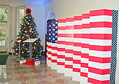 """The 2016 White House Christmas decorations are previewed for the press at the White House in Washington, DC on Tuesday, November 29, 2016. In the Booksellers guests will see a tribute to The Gift of Service, as we honor our military families through the First Lady and Dr. Biden's Joining Forces initiative. A giant flag installation will feature images of the First Family with military members and Gold Stars hung on the military tree to honor the fallen. For the second year, a digital interface will be available for guests to send messages to our troopsThe first lady's office released the following statement to describe those decorations, """"This year's holiday theme, 'The Gift of the Holidays,' reflects on not only the joy of giving and receiving, but also the true gifts of life, such as service, friends and family, education, and good health, as we celebrate the holiday season.""""<br /> Credit: Ron Sachs / CNP"""