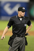 Home plate umpire Toby Basner during a game between the Empire State Yankees and Norfolk Tides in the first ever Triple-A contest to be held at Dwyer Stadium on April 20, 2012 in Batavia, New York.  (Mike Janes/Four Seam Images)