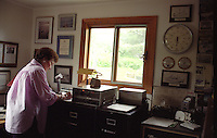 Photographed on Kodiak Island in the summer of 1996.  ..'Hello all mariners, hello all mariners, this is WBH-Two-Nine Kodiak.'.-- Peggy Dyson. Prior to the advent of faxes, email and cell phones, mariners throughout the North Pacific listened up when they heard WBH-29 Kodiak -- aka Peggy Dyson -- on the radio..In fact, they depended on it. Twice a day, every day for 25 years, Dyson broadcast the marine weather and personal messages to those at sea from her home in Kodiak on her single sideband radio. (© Karen Ducey)