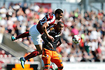 Lewin Nyatenga of Northampton in action with Leon Clarke of Sheffield Utd during the English League One match at Sixfields Stadium Stadium, Northampton. Picture date: April 8th 2017. Pic credit should read: Simon Bellis/Sportimage