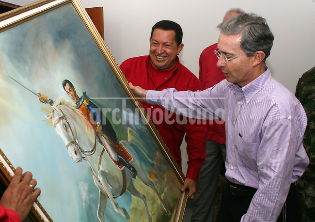 Venezuelan President Hugo Chavez presents  Colombian President  Alvaro Uribe with a picture of independence hero Simon Bolivar at Paraguana oil refinery complex in Punto Fijo. Chavez and Uribe mended their relation after the two countries had appeared to be on war footing in March, when Chavez sent troops to the Colombian border after  Uribe ordered a cross-border raid on a Farc rebel jungle camp in Ecuador.