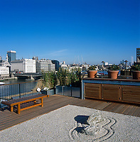 The roof terrace incorporates Japanese elements like this raked gravel 'garden'